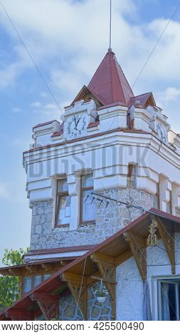 A Clock Tower On A Blue Sky Background. Yalta, Crimea