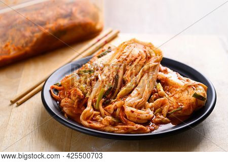 Kimchi Cabbage On Plate With Chopsticks, Popular Homemade Korean Traditional Fermented Side Dish Foo