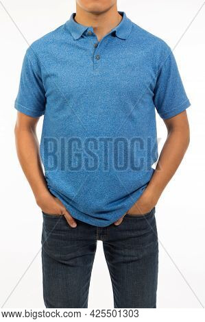 Teenager In A Cobalt Blue Shirt With Short Sleeve And Denim Jeans With Copy Space
