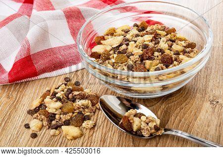 Checkered Napkin, Heap Of Muesli, Granola With Banana And Chocolate  In Transparent Bowl, Muesli In