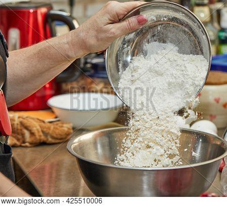 The Chef Is Pouring Flour Into Bowl For Making Cherry Pie, Clafoutis. Step By Step Recipe