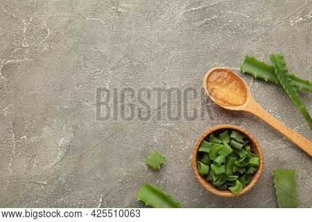 Aloe Vera Gel On Wooden Spoon With Aloe Vera On Grey Background. Top View.