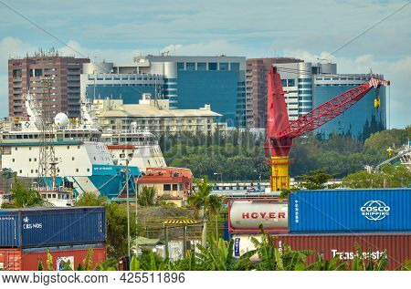 Labuan,malaysia-may 22,2021:view Of Open Yard Storage,warehouses,building And Offshore Vessels At Ra