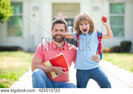 Teachers Day. American Father And Son Walking Trough School Park. Happy Family At School Yard.