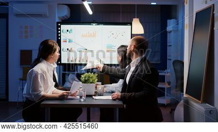 Multi Ethnic Teamwork Of Managers Analyzing Management Statistics Overworking In Office Meeting Room