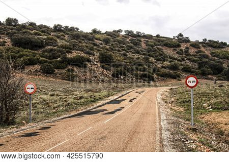 Lonely Road With Speed Road Sign In Spain