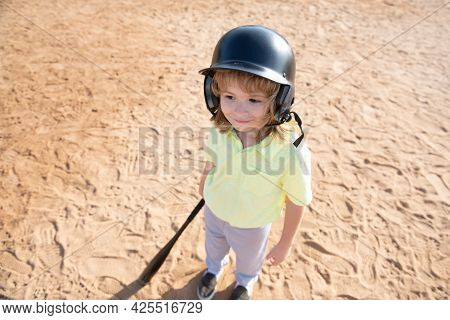 Funny Child Batter About To Hit A Pitch During A Baseball Game. Kid Baseball Ready To Bat. Fun Child