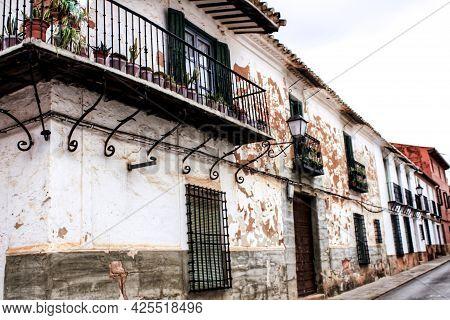Old White Facades, Balconies And Vintage Lanterns In A Street Of Villanueva De Los Infantes, Ciudad