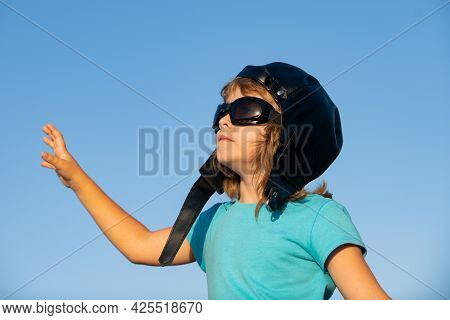 Portrait Of A Cute Child Boy With Pilot Helmet And Glasses. Kids Dream. Close Up Caucasian Kids Face