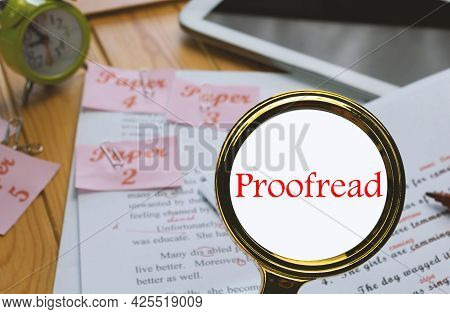 English Proofreading Paper On Table In Office With Office Supplies