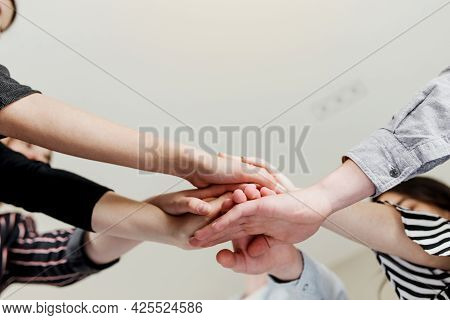 Group Of People Doing Handshake And Cross Hands. Friendship, Agreement, Cooperation Concept With You