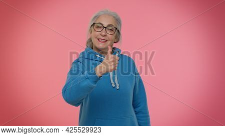 Mature Old Granny Gray-haired Grandmother In Casual Blue Hoodie Showing Thumbs Up And Nodding In App
