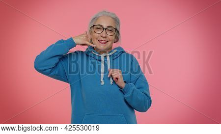Elderly Granny Gray-haired Woman Looking At Camera Doing Phone Gesture Like Says Hey You Call Me Bac
