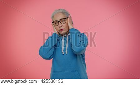 Dont Want To Hear And Listen. Frustrated Annoyed Irritated Elderly Granny Gray-haired Woman Covering