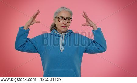 Elderly Granny Woman Showing Bla-bla-bla Nonsense Gesture With Hands And Rolling Eyes, Gossips, Empt