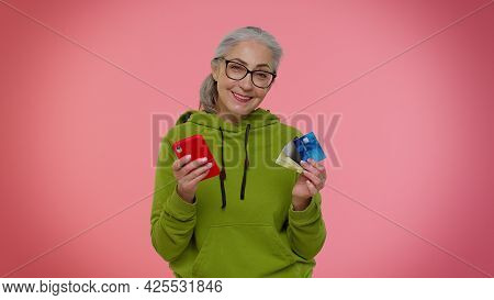 Senior Old Granny Woman Using Credit Plastic Cards And Mobile Phone While Transferring Money, Purcha