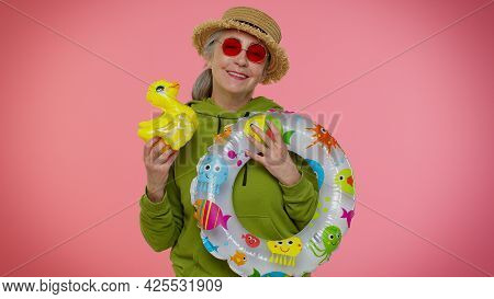Cheerful Senior Old Granny Woman Traveler Tourist Dancing Fooling With Swimming Ring And Inflatable