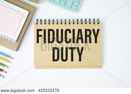 Paper With Text Fiduciary Duty On Wood Table.
