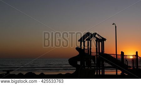 Silhouette Of Waterfront Playground Near Pier, Oceanside, California Usa. Place For Children, Beachf