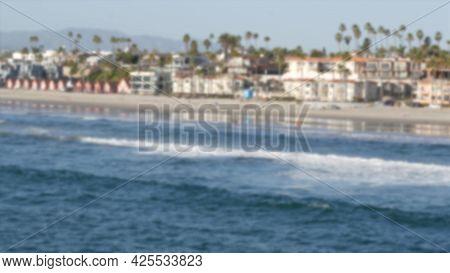 Defocused Pacific Ocean Coast From Pier. Sea Water Waves Tide, Shore Sand. Beachfront Vacations Reso