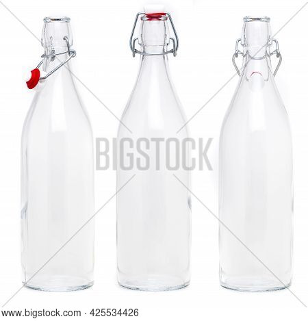 Several Glass Bottles With 1 Liter Soda Type Closures. Without Label And Isolated On White Backgroun