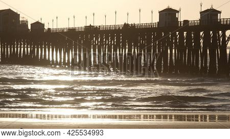 Wooden Pier On Piles, Silhouette At Sunset, California Usa, Oceanside. Waterfront Resort, Pacific Oc