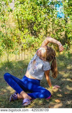 Defocus Caucasian Preteen Girl Practicing Yoga In Park, Forest, Outdoor, Outside. Meditation, Concen