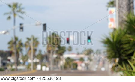 Defocused Palm Trees On Route 101 American Highway, Blurred Pacific Coast Tropical Street. Traffic L