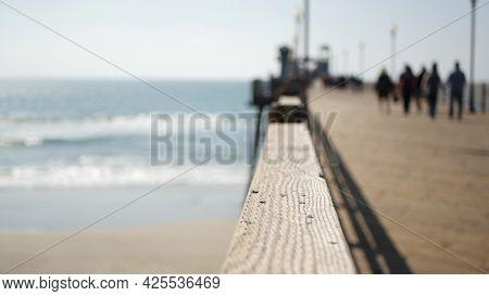 Railings Of Old Wooden Pier, People Walking On Waterfront Boardwalk, Oceanside Beach Atmosphere, Cal