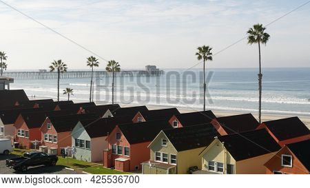 Colorful Waterfront Cottages In Oceanside, California Usa. Multicolor Bungalow Huts By Sea, Beachfro