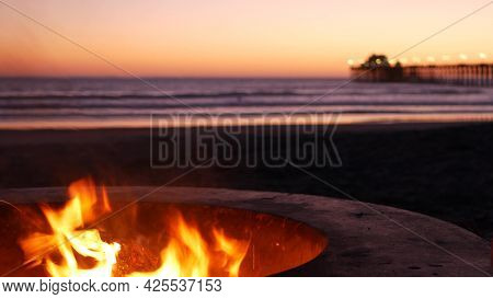 Campfire Pit By Oceanside Pier, California Usa. Camp Fire Burning On Ocean Beach, Bonfire Flame In C