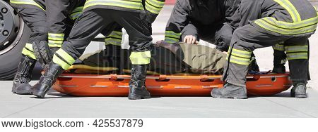 Team Of Firefighters During The Rescue And The Special Stretcher