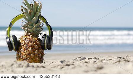 Funny Pineapple In Headphones, Sandy Ocean Beach, Blue Sea Water Waves, California Pacific Coast, Us