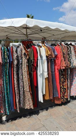 Clothes For Sale At Outdoor Market Stand In Summer