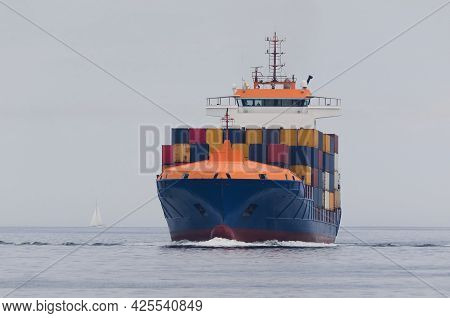 Container Ship - Freighter Sails On The Sea
