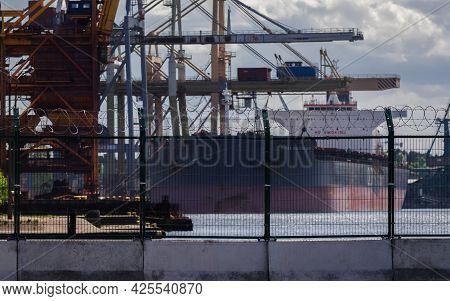 Swinoujscie, West Pomeranian - Poland - 2021: Separating  Seaport With Fence And Razor Wire