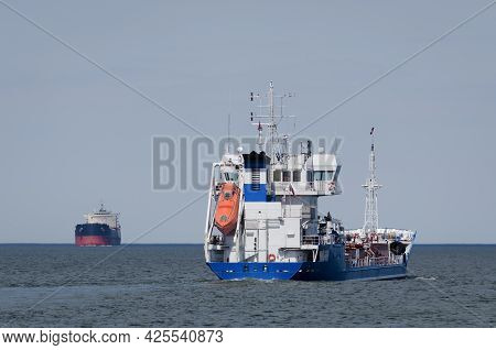 Maritime Transport - Merchant Vessels Sail On Waterway