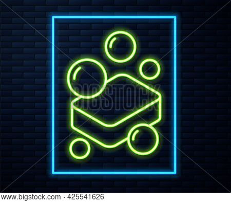 Glowing Neon Line Bar Of Soap Icon Isolated On Brick Wall Background. Soap Bar With Bubbles. Vector