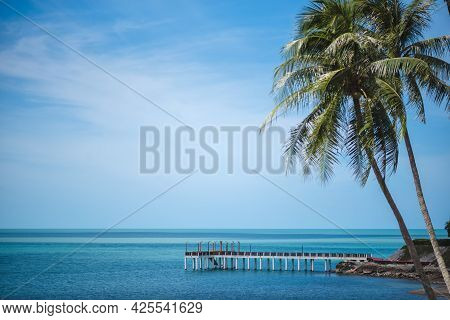 The Beautiful Scenery Of Tropical Wooden Bridge In The Sea With A Coconut Palm Tree In Khanom, Nakho