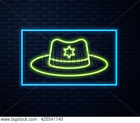 Glowing Neon Line Sheriff Hat With Badge Icon Isolated On Brick Wall Background. Vector