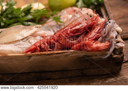 Fresh Fish On The Counter At A Fish Store With Red Prawns From Mazara Del Vallo. Close Up