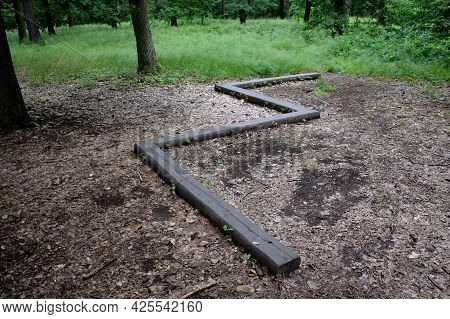 Zigzag On The Ground In The Forest Is Installed Wooden Beam For Children And Athletes, As A Training