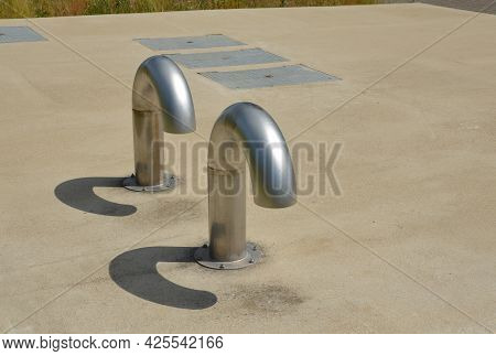 Stainless Steel Ventilation Duct In The Shape Of A Question Mark. This Involves Venting The Sewer Or