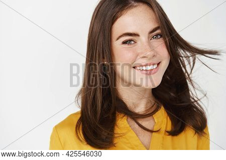 Beauty And Skin Care. Beautiful Woman Smiling With White Teeth, Showing Healthy Hair And Perfect Fac