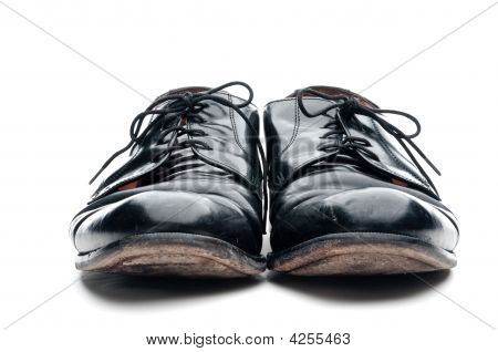 A Pair Of Old Worn Black Leather Business Shoes