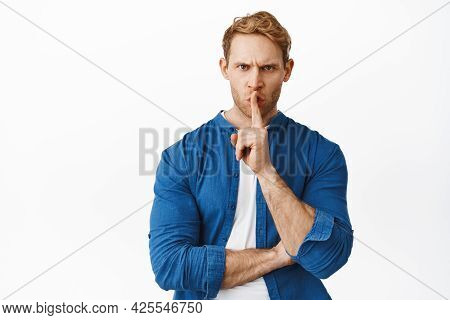Angry Redhead Man Shushing With Furious Face, Frowning And Say Shhh Hush, Be Quiet, Tell To Stay Sil