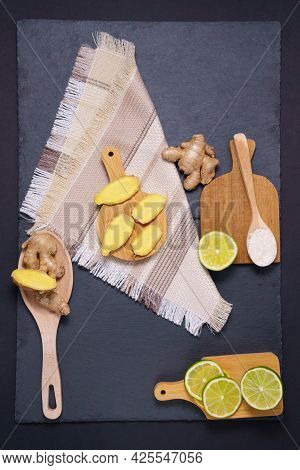 Lime Raw Ginger Honey Root. Dry Ginger Dark Background. Copy Space. Flat Lay. Vertical Photo