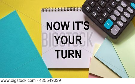 Now It's Your Turn To Write A Text, An Inscription, A Phrase In A Notepad, Which Lies On A Yellow Ba