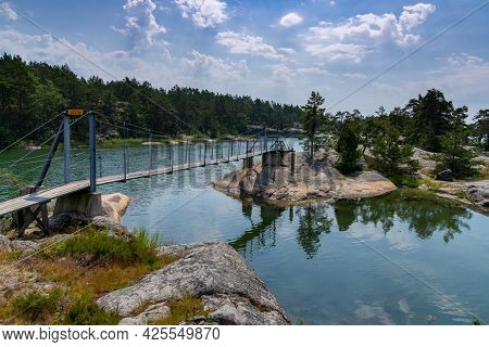 A Suspension Bridge Connecting Small Islands On A Coastal Archipelago With Lagoons And Forests On Th