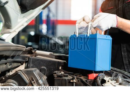 Close Up Hand Of Male Mechanic Changing Car Battery, Engineer Is Replacing Car Battery Because Car B